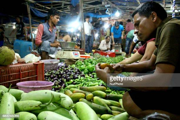 A customer checks the quality of the Vegetables in a market at Gurgaon Haryana on May 15 2017