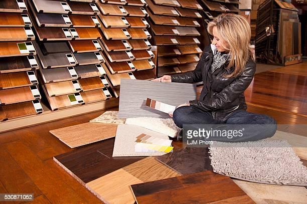 Customer Choosing Floor Coverings In A Retail Floor Establishment; Edmonton, Alberta, Canada