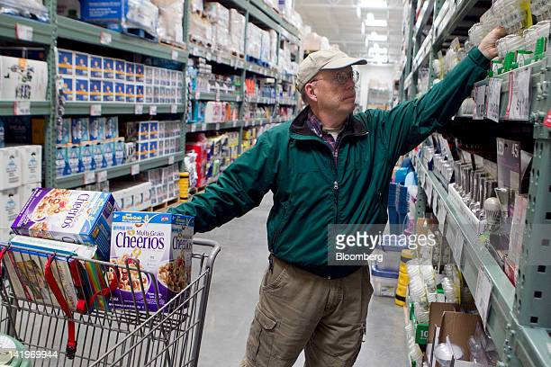 Customer Clay Henderson shops inside a BJ's Wholesale Club Inc store in Falls Church Virginia US on Tuesday March 27 2012 The US Bureau of Economic...