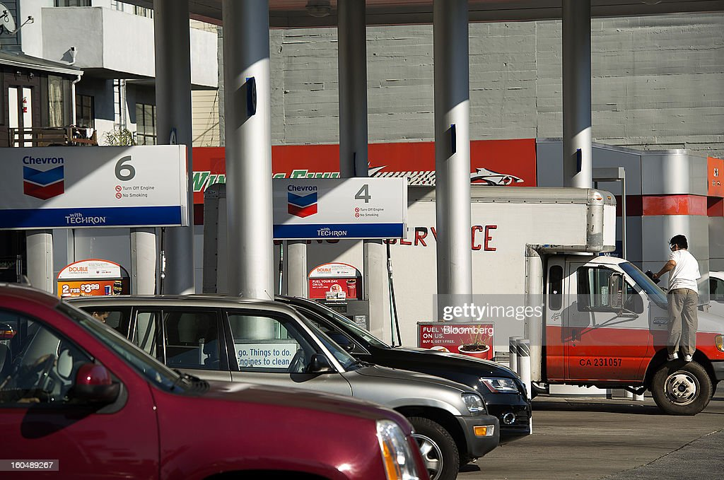 A customer cleans the windshield of a truck at a Chevron Corp. station in San Francisco, California, U.S., on Friday, Feb. 1, 2013. Chevron Corp., the second-largest U.S. energy company, said fourth-quarter profit increased 41 percent to a record $7.25 billion as it reported stronger refining results and a gain from an Australian natural gas field swap. Photographer: David Paul Morris/Bloomberg via Getty Images