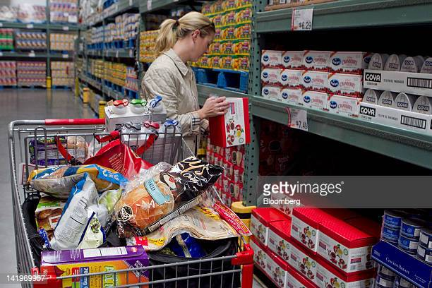 Customer Colette Bryson shops inside a BJ's Wholesale Club Inc store in Falls Church Virginia US on Tuesday March 27 2012 The US Bureau of Economic...