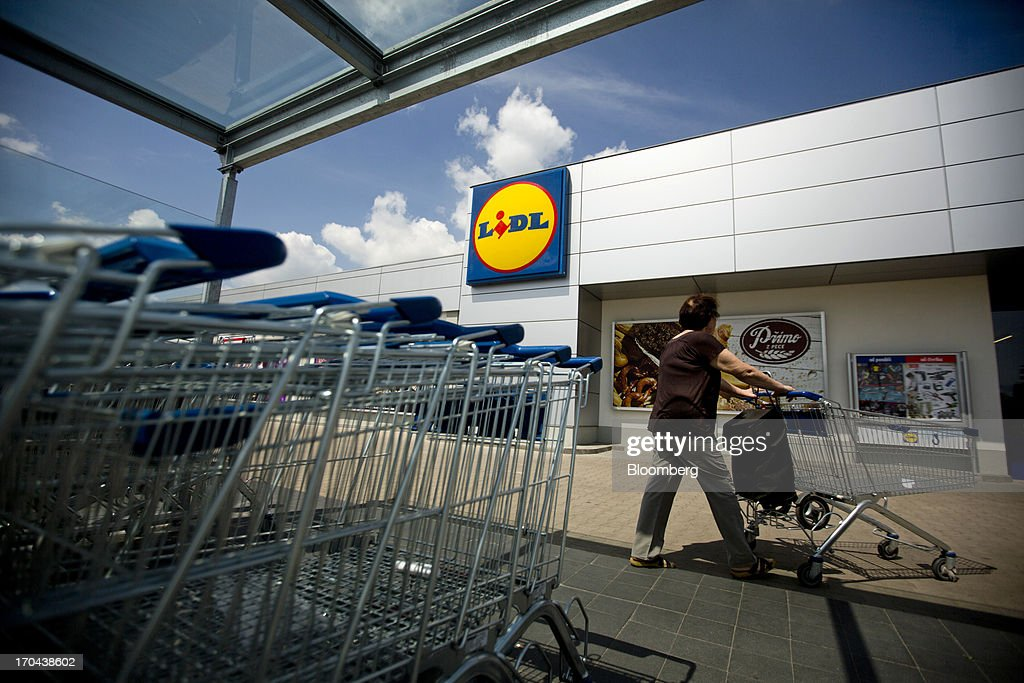 A customer collects a shopping cart from the parking lot before shopping inside a Lidl discount supermarket store, operated by Schwarz Group, in Prague, Czech Republic, on Thursday, June 13, 2013. Ahold and Tesco are tied as the Czech Republic's third-largest grocer by revenue behind Lidl discount store owner Schwarz Group and Rewe AV, which owns the Billa supermarkets, according to Krakow, Poland-based market researcher PMR. Photographer: Martin Divisek/Bloomberg via Getty Images
