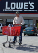 A customer comes out from a Lowe's store October 17 2011 in Alexandria Virginia Lowe's has announced that the company will close 20 of it's 1725...