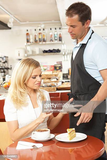 Customer Complaining to Waiter In Coffee Shop
