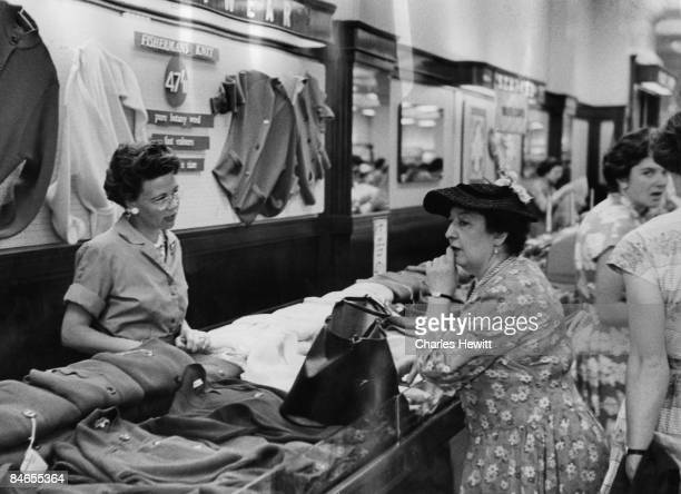A customer consults a sales assistant in the clothing department of Marks Spencer's Oxford Street branch 10th September 1955 Original Publication...