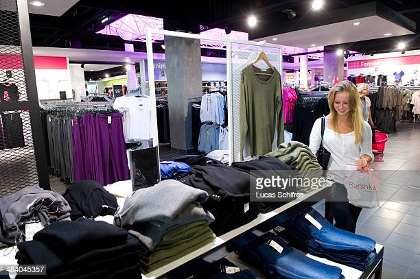 Customer Coralie Caratero browses for clothes in Tati's newly designed store in Belle Epine mall on September 25 in Thiais near Paris France Tati is...
