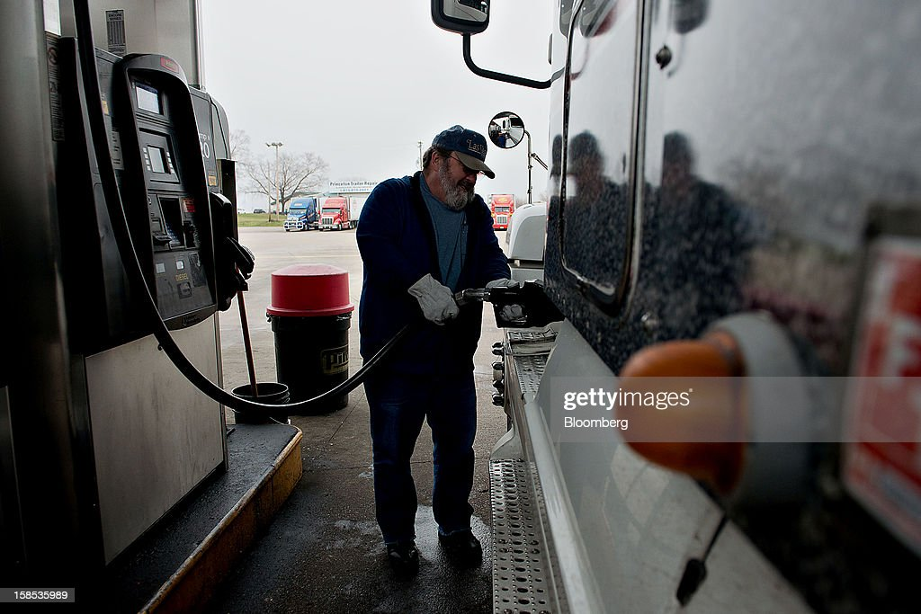 Customer Dave Graves fills his truck with fuel at a gas station in Princeton, Illinois, U.S., on Tuesday, Dec. 18, 2012. Retail gasoline in the U.S. fell to the lowest level in a year as refineries restored production and stockpiles rose to an eight-month high, blunting criticism of President Barack Obama's energy policies. Photographer: Daniel Acker/Bloomberg via Getty Images