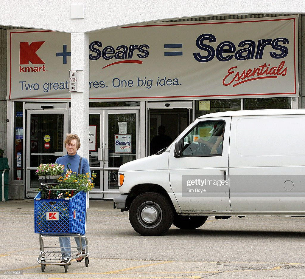 A customer departs a current Kmart store May 18, 2005 in Palatine, Illinois. This particular Kmart is in transition to become one of Sears' new stores called 'Sears Essentials.' Kmart recently bought Sears, Roebuck and Co. for $12.3 billion.