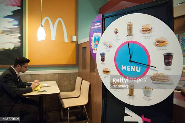 A customer dines at a McDonald's Corp restaurant in New York US on Thursday Oct 22 2015 McDonalds Corp shares soared the most in almost seven years...