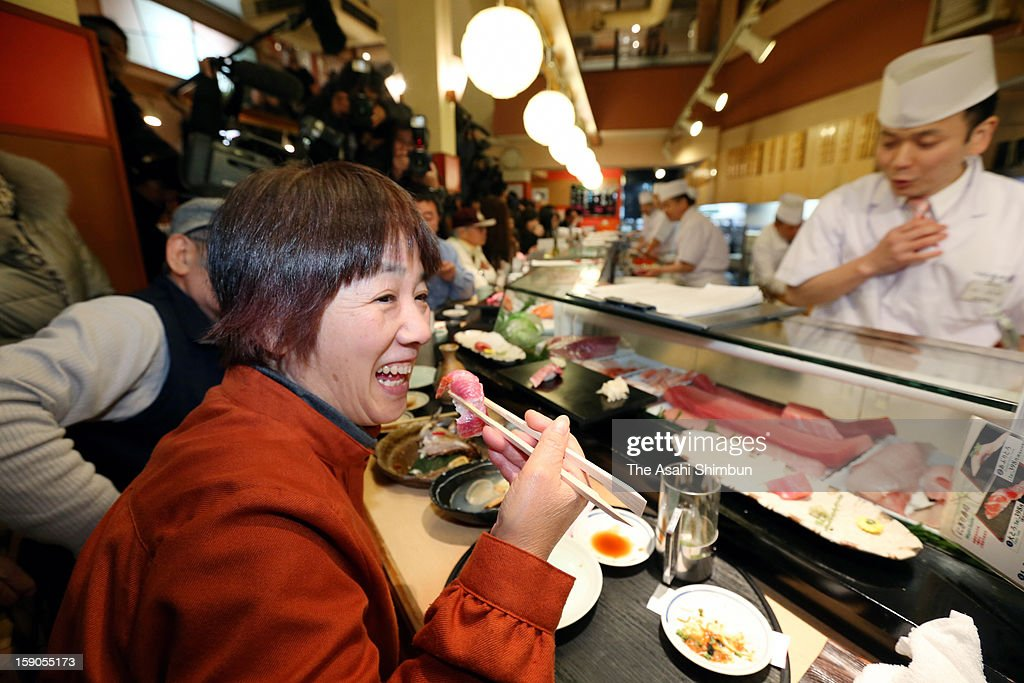 A customer eats tuna sushi made from the 222-kilogram bluefin tuna, that was auctioned at 155.4 million Japanese yen (approximately 1.8 million U.S. Dollars) at the opening day of Tsukiji Wholesale Fish Market on January 5, 2013 in Tokyo, Japan. The price was as triple as last year's 56.5 million yen.