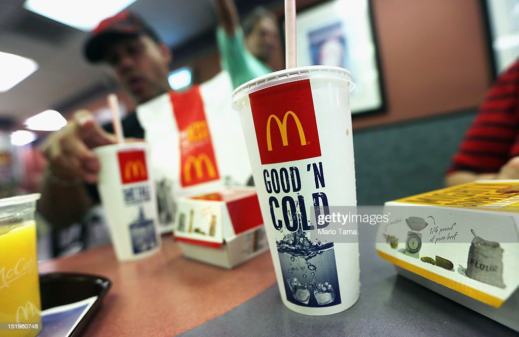 A customer eats with a 21 ounce cups of soda at a Manhattan McDonalds on September 13, 2012 in New York City. In an effort to combat obesity, the New York City Board of Health voted to ban the sale of large sugary drinks. The controversial measure bars the sale of sugar drinks larger than 16 ounces at restaurants and concessions.