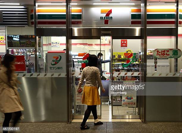 A customer enters a 7Eleven convenience store operated by Seven I Holdings Co in Tokyo Japan on Thursday April 3 2014 Seven I forecasted a 47 percent...
