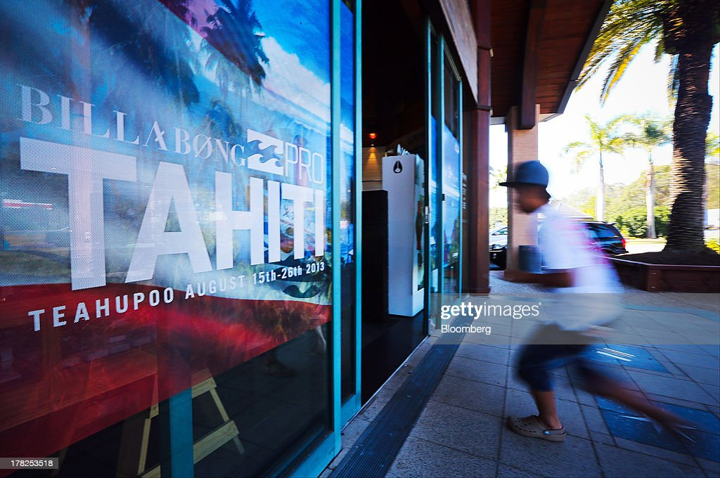 A customer enters a Billabong International Ltd. retail store at the company's headquarters in Burleigh Heads, Australia, on Wednesday, Aug. 28, 2013. Billabong, the surf brand founded in 1973, helped sell Australian surfing culture worldwide and rose to a market value of A$3.84 billion ($3.45 billion) at its peak in 2007 said its 40-year-old surf brand was worthless after the companys losses tripled amid store closures, firings and a breach of debt terms. Photographer: Patrick Hamilton/Bloomberg via Getty Images