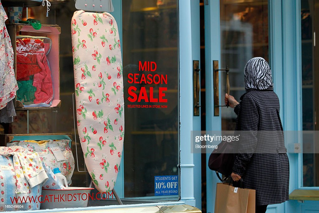A customer enters a Cath Kidston Ltd. store advertising a sale in Manchester, U.K., on Monday, April 1, 2013. U.K. retail sales unexpectedly stagnated in March in a sign that consumer spending remains under pressure from higher energy bills and weak wage growth. Photographer: Paul Thomas/Bloomberg via Getty Images