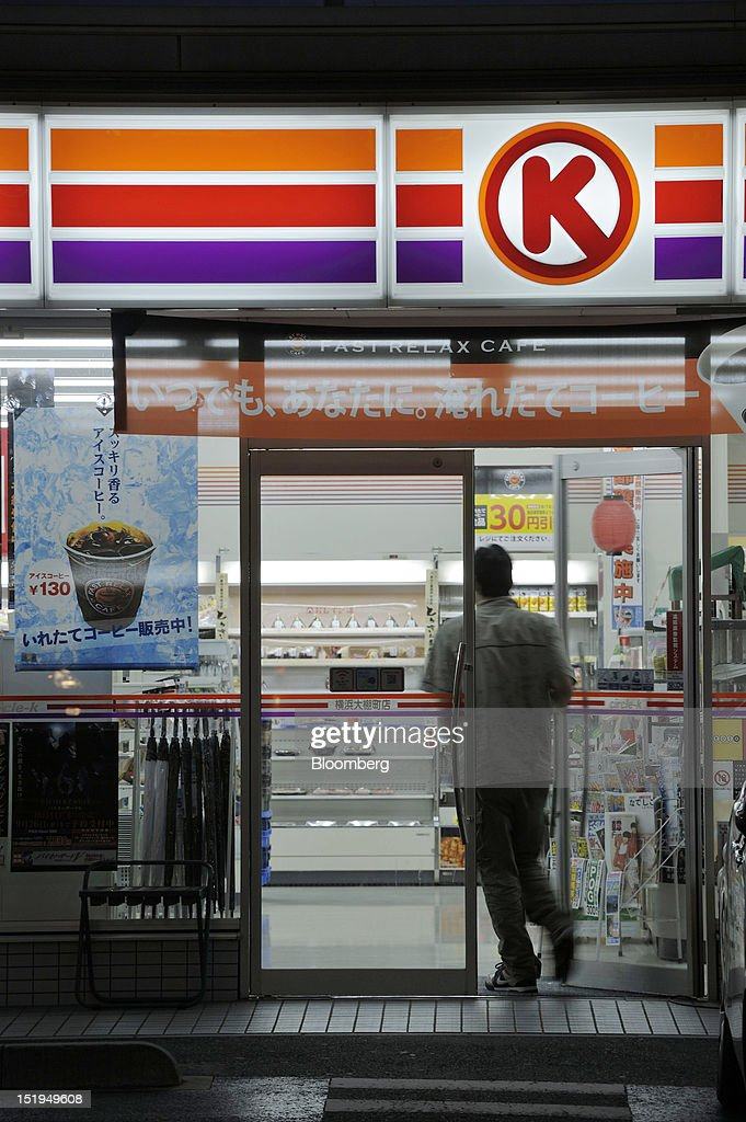 A customer enters a Circle K convenience store, operated by Circle K Sunkus Co., at night in Yokohama City, Kanagawa Prefecture, Japan, on Tuesday, Sept. 11, 2012. Sales at Japan's convenience stores declined 3.3 percent in July from a year ago on a same-store basis, according to the Japan Franchise Association. Photographer: Akio Kon/Bloomberg via Getty Images