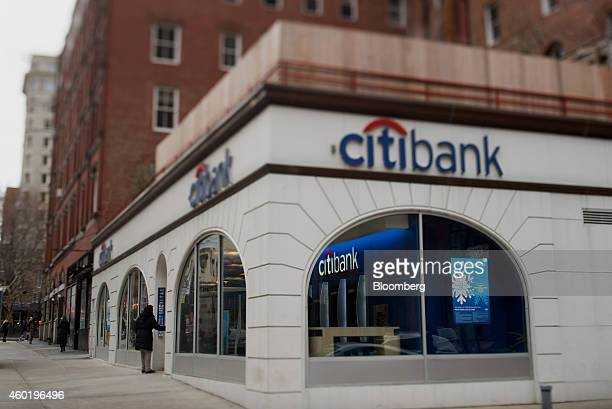 A customer enters a Citigroup Inc Citibank branch in this photo taken with a tiltshift lens in New York US on Monday Dec 8 2014 US stocks dropped...