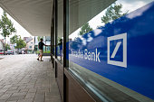 A customer enters a Deutsche Bank AG branch in Boblingen Germany on Monday July 25 2016 Deutsche Bank Chief Executive Officer John Cryan will try to...