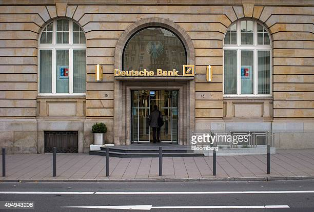 A customer enters a Deutsche Bank AG branch in Frankfurt Germany on Thursday Oct 29 2015 Deutsche Bank AG said it will shrink the workforce by about...