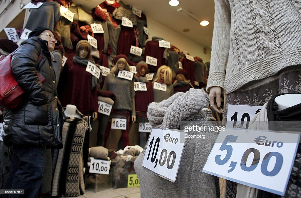 A customer enters a discount women's knitwear store in Rome, Italy, on Tuesday, Dec. 18, 2012. Italian Prime Minister Mario Monti, who is under pressure from euro-area and business leaders to enter the Italian election campaign, plans to quit once parliament passes his budget this week. Photographer: Alessia Pierdomenico/Bloomberg via Getty Images
