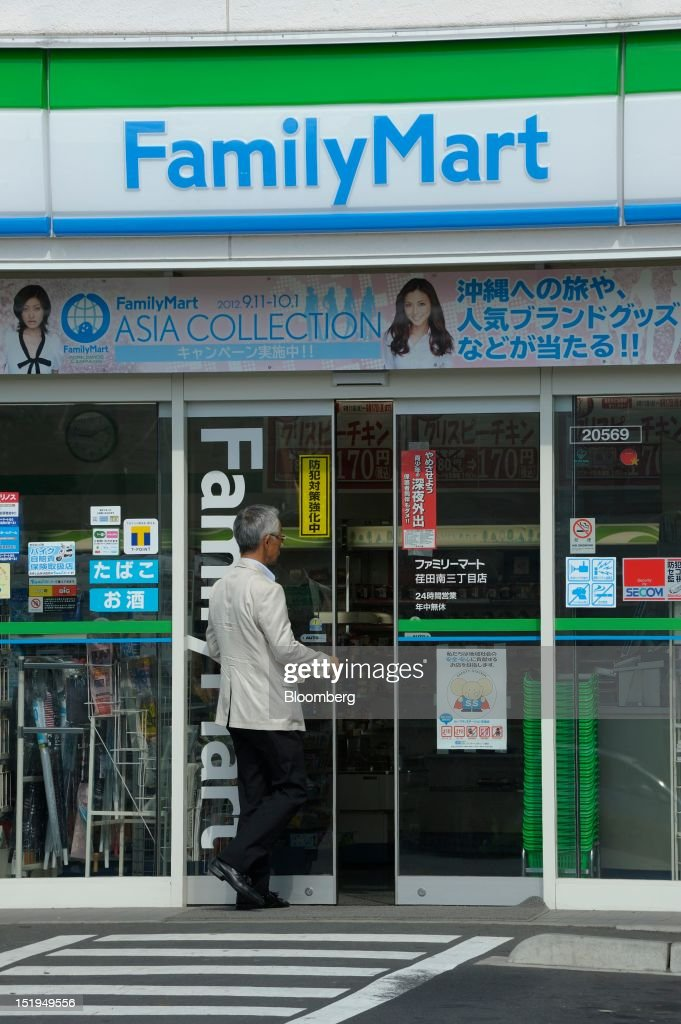 A customer enters a FamilyMart Co. convenience store in Yokohama City, Kanagawa Prefecture, Japan, on Tuesday, Sept. 11, 2012. Sales at Japan's convenience stores declined 3.3 percent in July from a year ago on a same-store basis, according to the Japan Franchise Association. Photographer: Akio Kon/Bloomberg via Getty Images