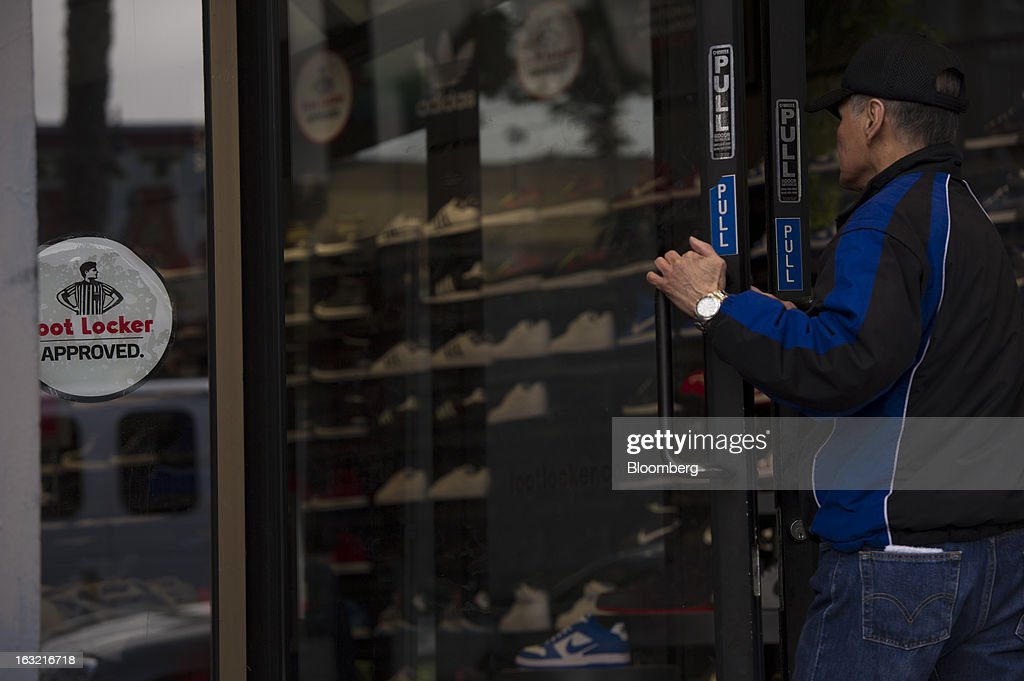 A customer enters a Foot Locker Inc. store in San Francisco, California, U.S., on Tuesday, March 5, 2013. Foot Locker Inc. is expected to release earnings data on March 8. Photographer: David Paul Morris/Bloomberg via Getty Images