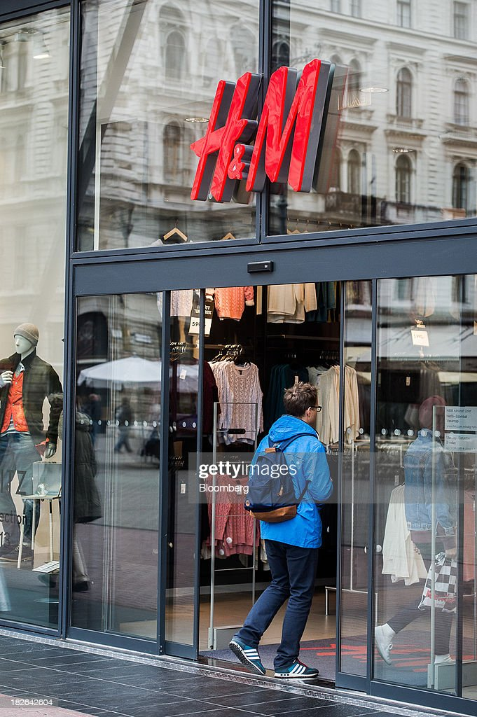 A customer enters a Hennes & Mauritz AB (H&M) fashion store in Budapest, Hungary, on Wednesday, Oct. 2, 2013. 'The retail sales environment in Europe, especially in Spain, has become less challenging in the last few weeks, while the weather overall has also been more stable,' Anne Critchlow, a London-based analyst at Societe Generale, said. Photographer: Akos Stiller/Bloomberg via Getty Images