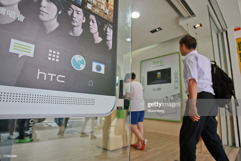 A customer enters a HTC Corp. store in Taipei, Taiwan, on Thursday, July 4, 2013. HTC is scheduled to announce second quarter earnings on July 8. Photographer: Maurice Tsai/Bloomberg via Getty Images