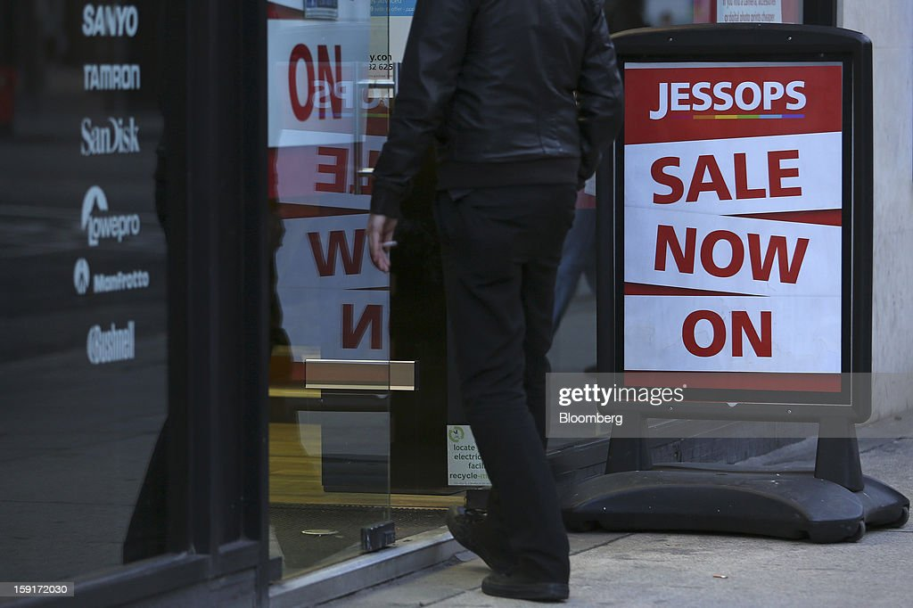 A customer enters a Jessops camera store advertising a sale in London, U.K., on Wednesday, Jan. 9, 2013. PricewaterhouseCoopers LLC were today appointed administrators of U.K. camera retailer The Jessop Group Ltd. Photographer: Chris Ratcliffe/Bloomberg via Getty Images