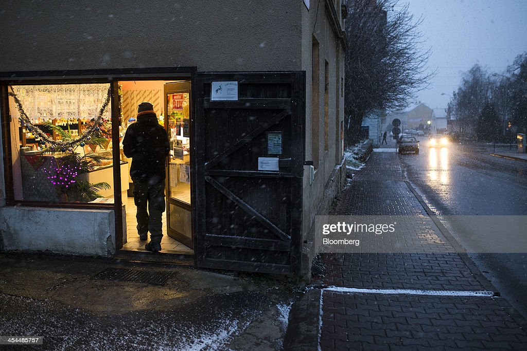 A customer enters a local store illuminated by electric light in a town under threat from the expansion of nearby lignite mine excavations in Horni Jiretin, Czech Republic, on Friday, Dec. 6, 2013. The government may set up a joint company with Severni Energeticka that will seek lifting current environmental limits on lignite mining, Lidove Noviny reports, citing proposal submitted by Industry and Trade Ministry. Photographer: Bartek Sadowski/Bloomberg via Getty Images