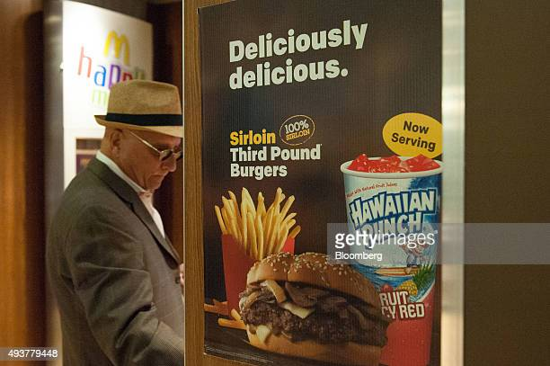 A customer enters a McDonald's Corp restaurant in New York US on Thursday Oct 22 2015 McDonalds Corp shares soared the most in almost seven years...