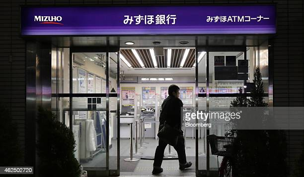 A customer enters a Mizuho Bank Ltd branch in Tokyo Japan on Thursday Jan 29 2015 Mizuho Financial Group Inc Japan's third largest bank is scheduled...