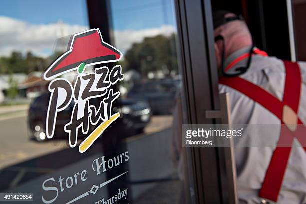 A customer enters a Pizza Hut restaurant in Princeton Illinois US on Thursday Oct 1 2015 Yum Brands Inc owner of the Taco Bell Pizza Hut and KFC...