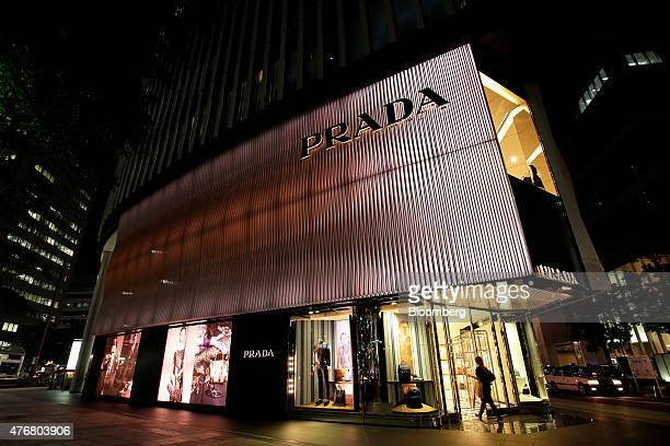 A customer enters a Prada SpA store at night in Nagoya Aichi Prefecture Japan on Tuesday June 9 2015 Japan's Gross domestic product expanded an...