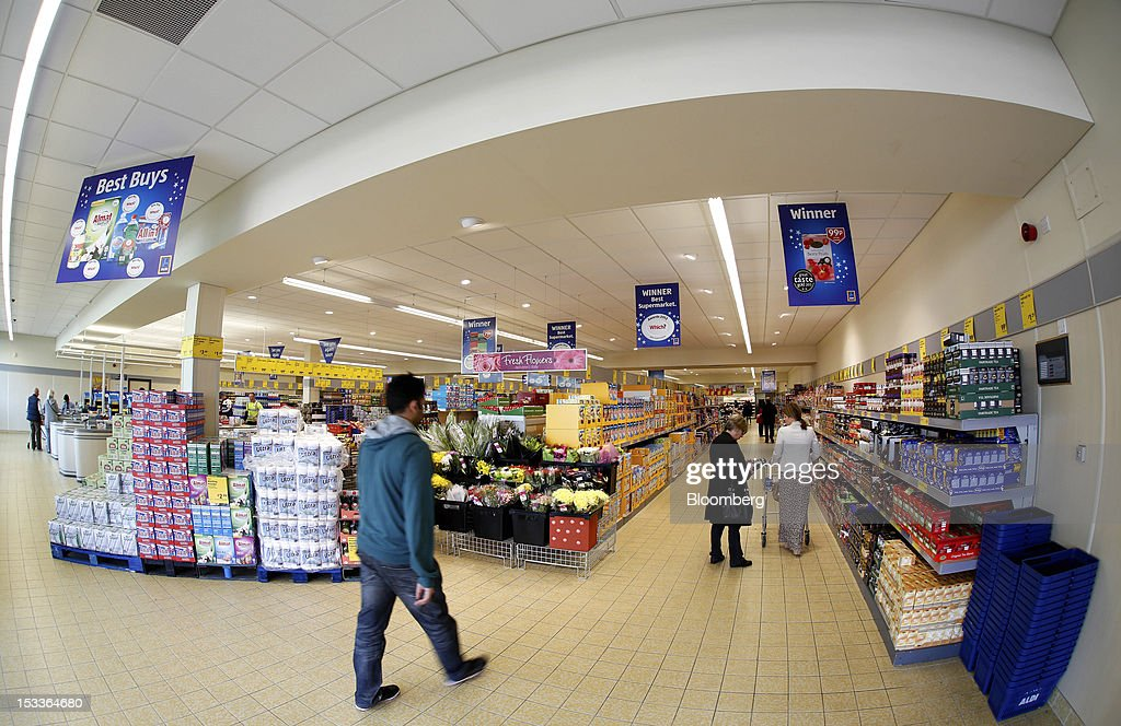 A customer enters a supermarket operated by Aldi Group, Germany's biggest discount-food retailer, in Manchester, U.K., on Thursday, Oct. 4, 2012. U.K. shop-price inflation slowed in September as retailers offered discounts to attract cash-strapped consumers, the British Retail Consortium said. Photographer: Paul Thomas/Bloomberg via Getty Images