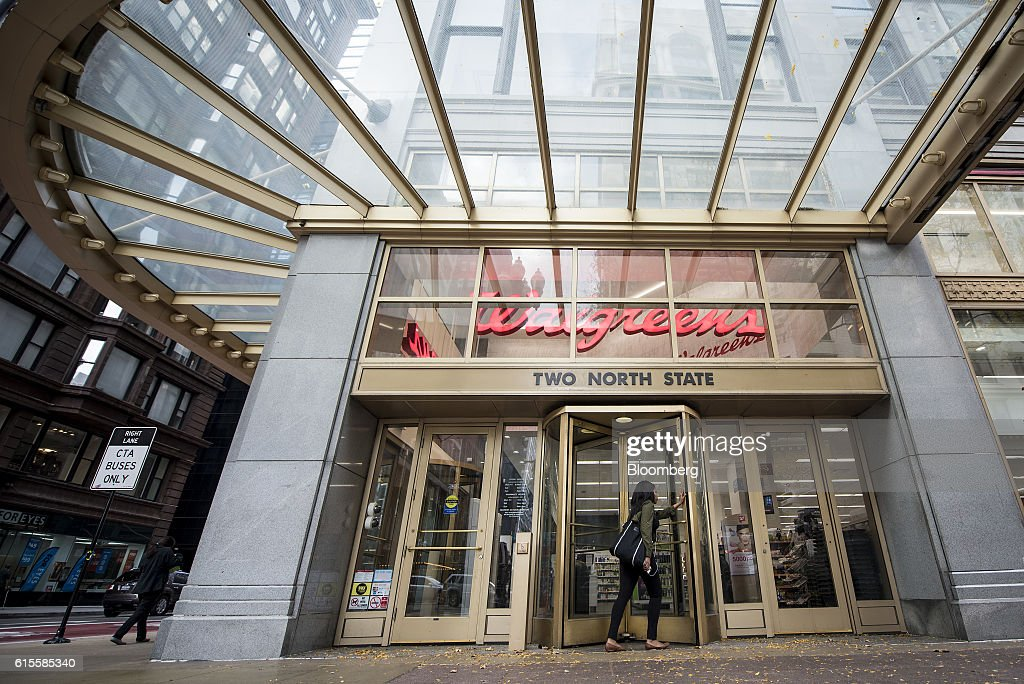 A customer enters a Walgreens Boots Alliance Inc  store in downtown  Chicago  Illinois. Inside A Walgreens Boots Alliance Location Ahead Of Earnings