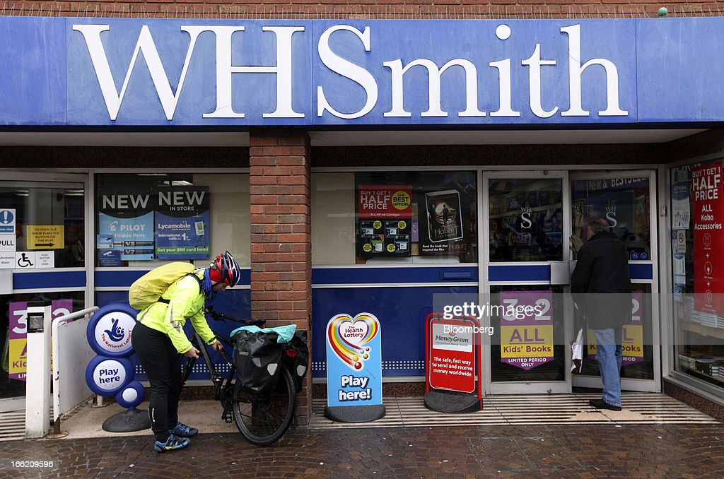 A customer enters a WH Smith Plc store in Folkestone, U.K., on Tuesday, April 9, 2013. WH Smith Plc, the book and magazine retailer with more than 1,100 U.K. outlets, is scheduled to announce earnings on April 11. Photographer: Chris Ratcliffe/Bloomberg via Getty Images