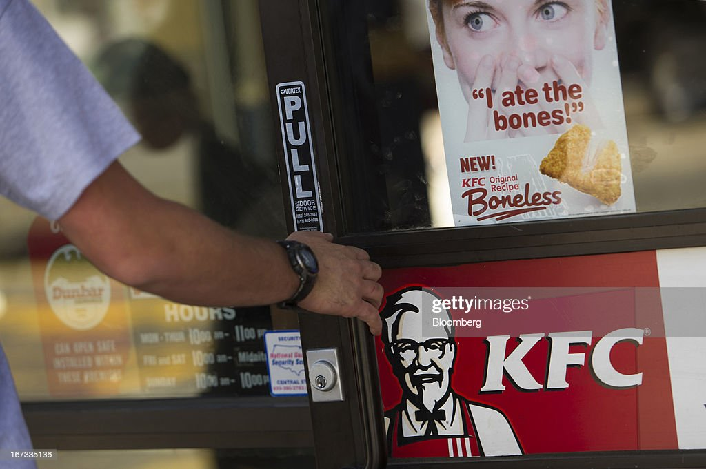 A customer enters a Yum! Brands Inc. Kentucky Fried Chicken restaurant in San Francisco, California, U.S., on Tuesday, April 23, 2013. Yum! Brands Inc., owner of the KFC and Pizza Hut dining chains, posted first-quarter profit that topped analysts' estimates as new menu items helped Taco Bell's domestic sales. Photographer: David Paul Morris/Bloomberg via Getty Images