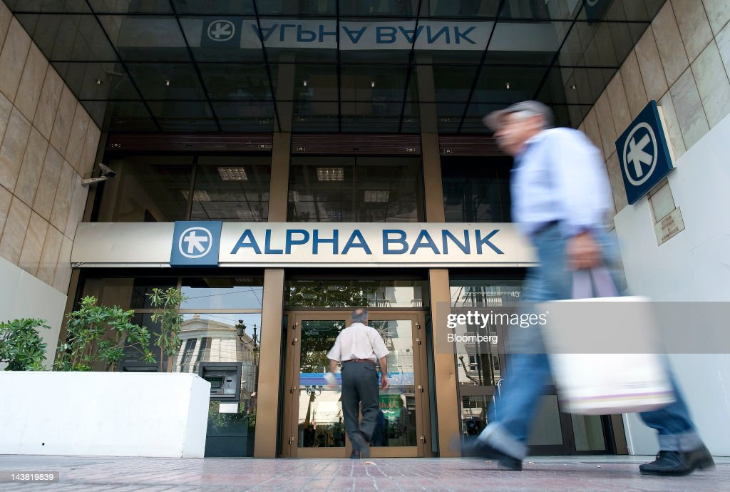A customer enters an Alpha Bank AE branch in Athens, Greece, on Friday, May 4, 2012. European stocks dropped as investors awaited today's American payrolls report and elections in France, Greece, Italy and Germany this weekend. Photographer: Simon Dawson/Bloomberg via Getty Images