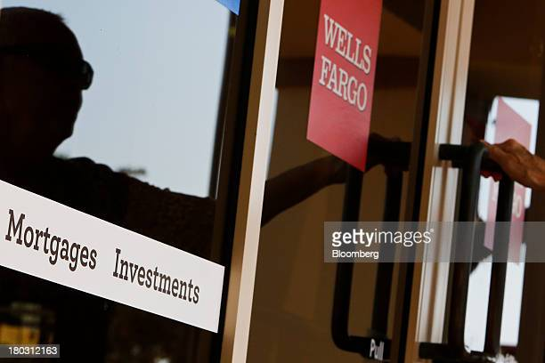 A customer enters at a Wells Fargo Co bank branch in Hermosa Beach California US on Tuesday Sept 10 2013 Mortgage applications in the US plunged last...