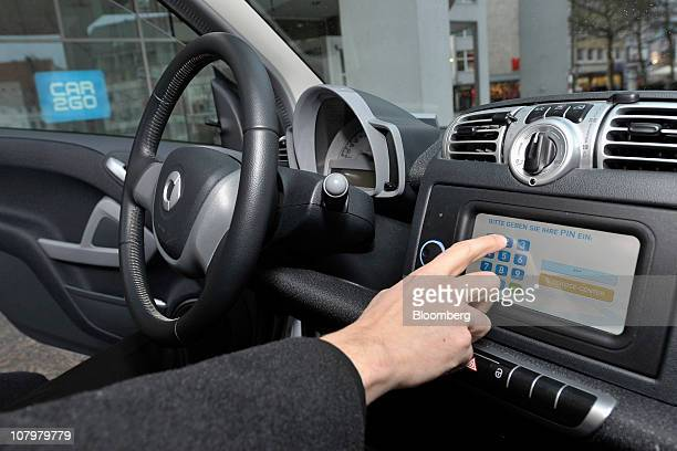 A customer enters his pin number into a vehicle reservation display to activate a Daimler AG's Car2go rental auto in Ulm Germany on Monday Jan 10...