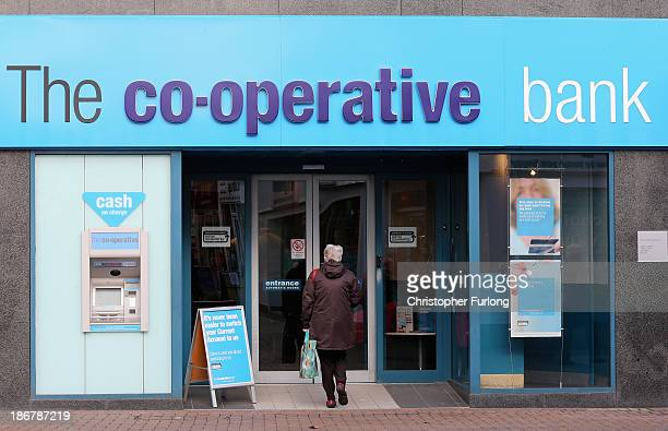 A customer enters the Crewe branch of the Cooperative Bank on November 4 2013 in Crewe United Kingdom The Cooperative Bank has announced plans to cut...