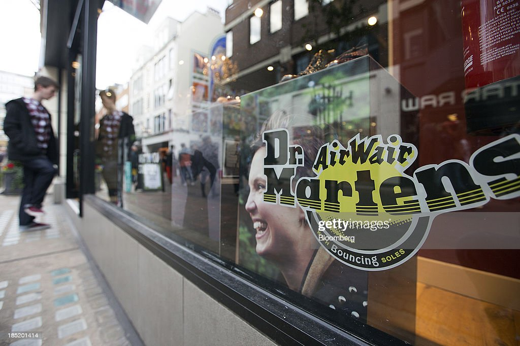 A customer enters the Dr. Martens footwear store in Convent Garden in London, U.K., on Friday, Oct. 18, 2013. Permira Advisers LLP, the London-based private-equity firm that owns clothing brand Hugo Boss, is in advanced talks to buy iconic British punk-boot maker Dr. Martens, said a person with knowledge of the negotiations. Photographer: Simon Dawson/Bloomberg via Getty Images