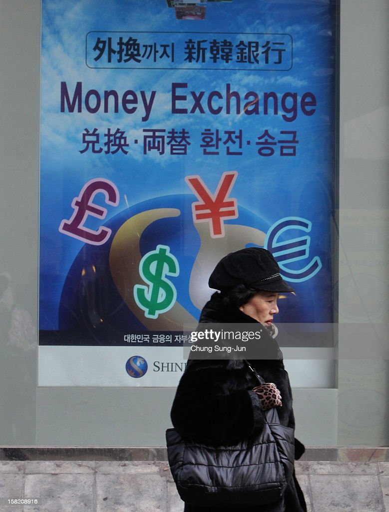 A customer exits a bank on December 11, 2012 in Seoul, South Korea. One of the main South Korean presidential election campaign issues is the economy, as the chaebol, South Korea's business conglomerate, dominates the country's wealth while the economic life of middle class people has not been improving.