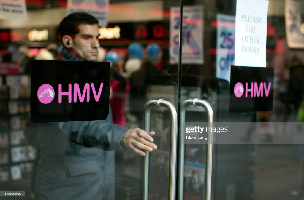 A customer exits a branch of an HMV store in London, U.K., on Tuesday, Jan. 15, 2013. Endless LLP, a private-equity firm that focuses on companies in distress, contacted HMV Group Plc's prospective administrators with a view to buying the U.K.'s biggest retailer of CDs and DVDs. Photographer: Simon Dawson/Bloomberg via Getty Images