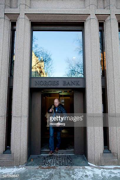 A customer exits a branch of Norges Bank Norway's central bank in Oslo Norway on Wednesday Dec 1 2010 Norwegian manufacturing expanded last month at...