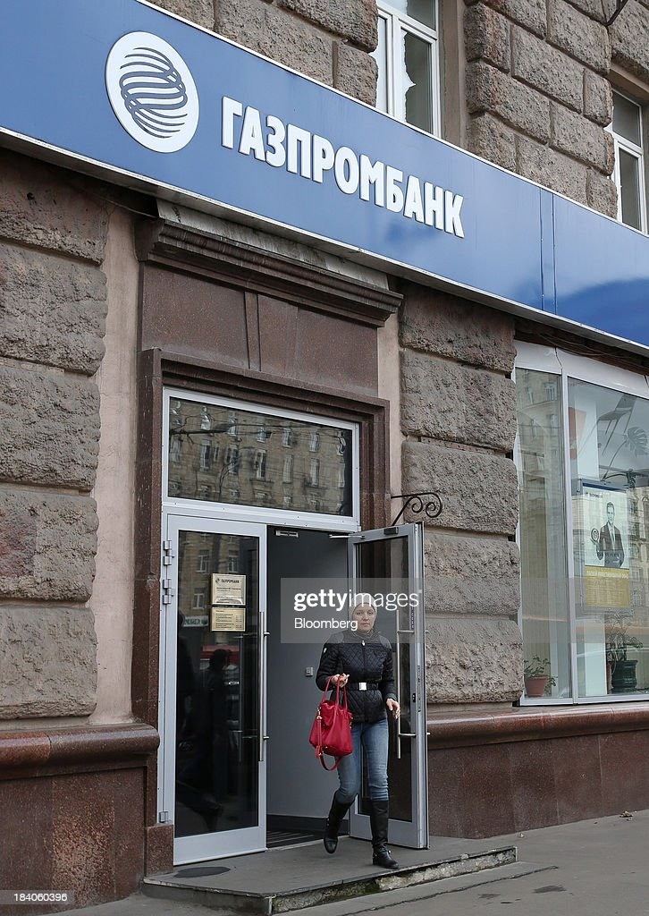 A customer exits a Gazprombank OJSC bank branch in Moscow, Russia, on Friday, Oct. 11, 2013. Tinkoff Credit Systems is valued at $2.5b to $3b for London IPO, which reflects P/E multiple of 9.5 to 11.4, Vedomosti reports, citing unidentified people familiar with offering documents. Photographer: Andrey Rudakov/Bloomberg via Getty Images
