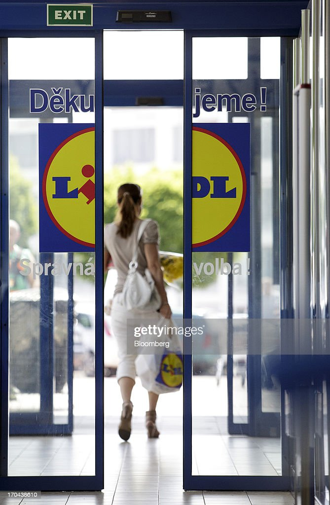 A customer exits a Lidl discount supermarket store, operated by Schwarz Group, in Prague, Czech Republic, on Thursday, June 13, 2013. Ahold and Tesco are tied as the Czech Republic's third-largest grocer by revenue behind Lidl discount store owner Schwarz Group and Rewe AV, which owns the Billa supermarkets, according to Krakow, Poland-based market researcher PMR. Photographer: Martin Divisek/Bloomberg via Getty Images