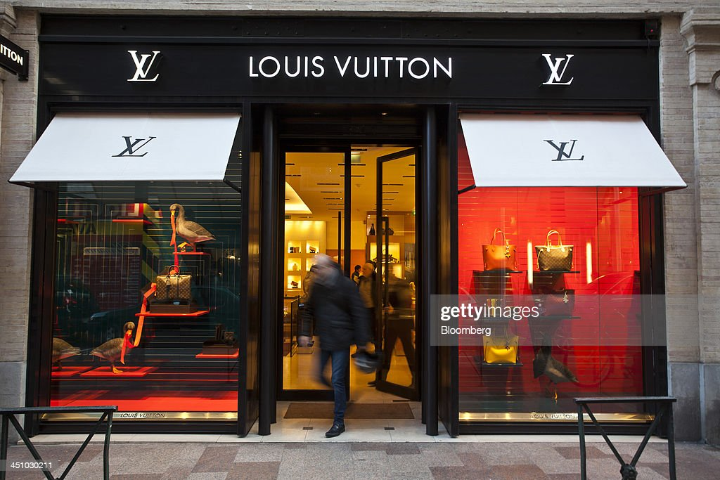A customer exits a LVMH Moet Hennessy Louis Vuitton SA luxury retail store in Toulouse, France, on Wednesday, Nov. 20, 2013. France's gross domestic product fell 0.1 percent in the three months through September, national statistics office Insee said in an e-mailed statement. Photographer: Balint Porneczi/Bloomberg via Getty Images