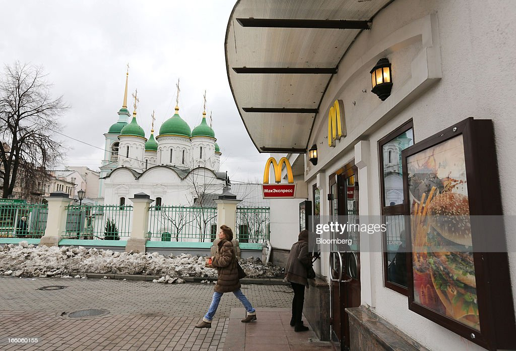 A customer exits a McDonald's food restaurant in Moscow, Russia, on Sunday, April 7, 2013. McDonald's Corp., which virtually created the market for burgers and fries in the country and convinced Russians it's OK to eat with their hands, must fend off a growing challenge from rivals Burger King Worldwide Inc., Subway Restaurants, Yum! Brands Inc. and Wendy's Co. Photographer: Andrey Rudakov/Bloomberg via Getty Images