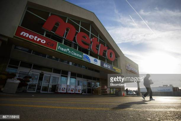 A customer exits a Metro Inc grocery store in Toronto Ontario Canada on Monday Oct 2 2017 Canadian grocer Metro Inc agreed to buy pharmacy chain Jean...